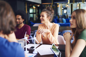 Image- smiling coworkers, why customized training is right for your business